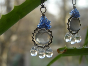 Made with dark oxidized sterling silver wrapped around silver wire. Glass stones are matched with a big grey moonstone.